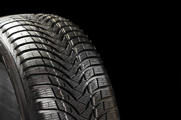 winter tyre on black