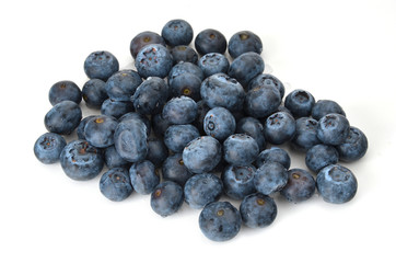 A small pile of blueberries on white background