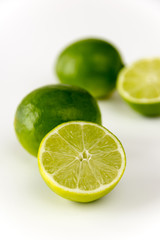 CLose-up of cut limes isolated on white