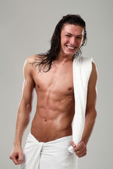 Young sexy man with towel