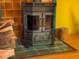 Wood stove in front of colorful wall