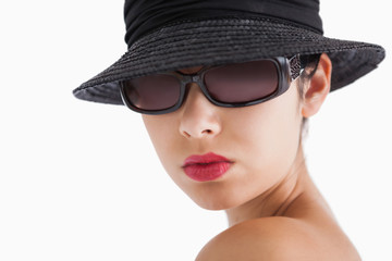Woman wearing sun glasses and hat