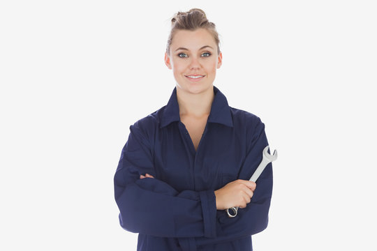 Female mechanic holding spanner