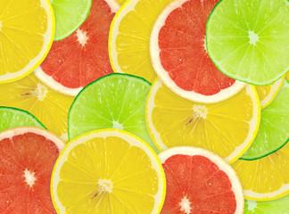 Tuinposter Plakjes fruit Abstract background of citrus slices. Closeup. Studio photograph
