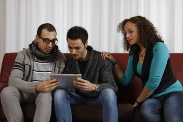 Bored Woman and Men Playing with Tablet PC