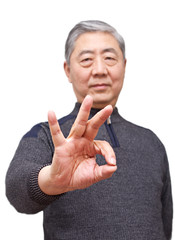 Senior asian man showing finger gesture