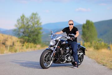 Man posing on a custom made motorcycle