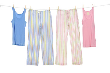 Female shirt and trousers clothespins on rope