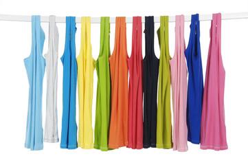 Set of rainbow many peignoir hanging on wooden hangers