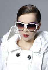 Portrait of attractive young woman in sunglasses posing