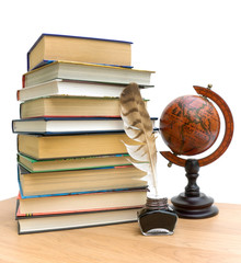 books, pen, ink and vintage globe on white background