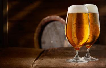 Two glasses of fresh foamy beer