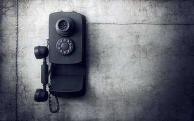 Vintage phone on concrete wall