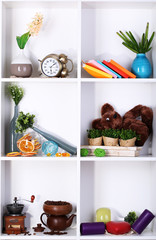 Beautiful white shelves with scattered different home related