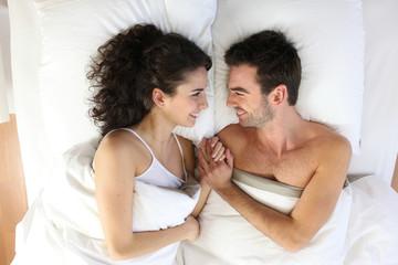 Obraz Couple lying in bed - fototapety do salonu