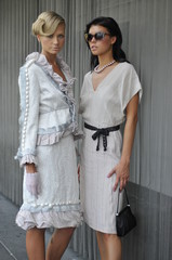 Two fashion models posing in couture designer clothes