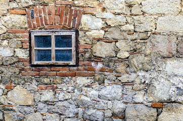 Small window on a stone wall