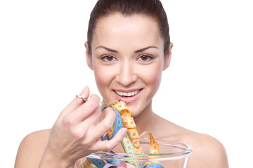 Humorous portrait of a young woman keeping a diet and eating mea