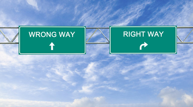Road sign to right and wrong way