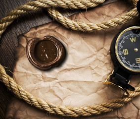 compass and rope on old paper background