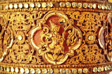 A gold pattern on the wall of old stupa