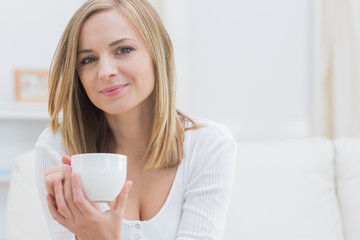 Portrait of young woman with coffee cup