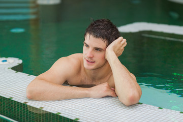 Smiling man relaxing in the pool