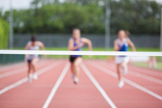 Athletes running towards finish line