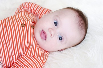 The surprised baby in an orange striped jacket (4 months)