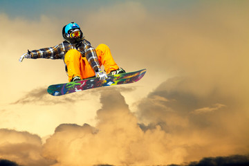 Wall Mural - snowboarder at sunset