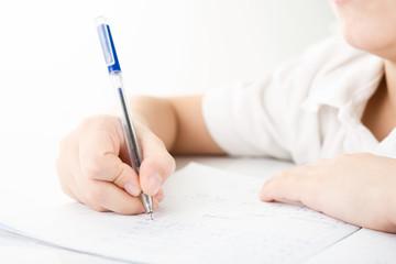 Child hands writing a homework