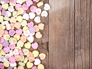 heart shape candy on wooden plank