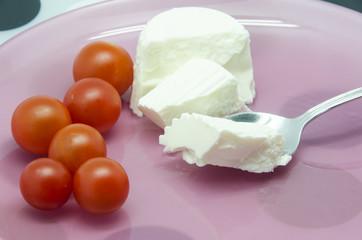 Fresh cheese with cherry tomatoes