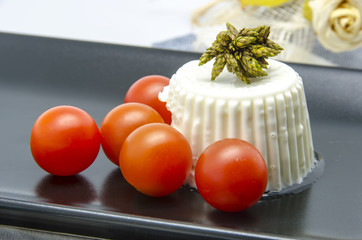 Fresh cheese with cherry tomatoes