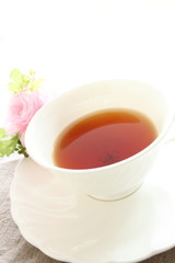 english black tea with flower on white background