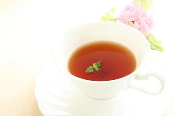 english mint black tea with flower on white background