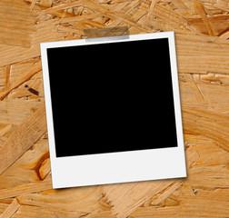 Polaroid Bild auf Holzplatte