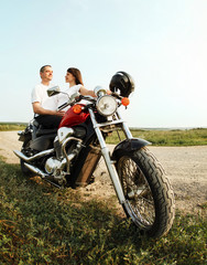 Fototapete - Young biker couple on the country road