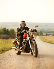 Wall Mural - Biker on the country road