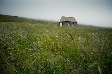 traditional small house in the middle of grassland