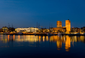 Oslo City Hall and harbour, twilight.