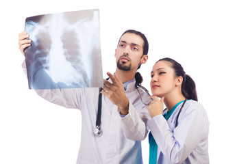 Two doctors looking at x-ray image on white
