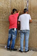 Jewish worshipers pray at the Wailing Wall. Jerusalem, Israel.