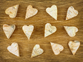 Wooden carved hearts on a retro wooden background