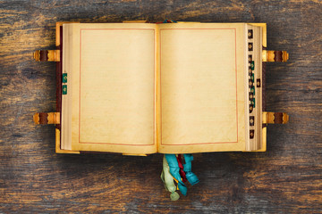 Ancient book on a wooden background