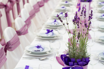 wedding or another event party table set with flower decoration