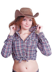 cute curly girl in a cowboy hat