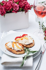appetizer, toast with cheese, pepper and rosemary