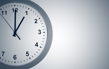 Closeup of clock on grey background