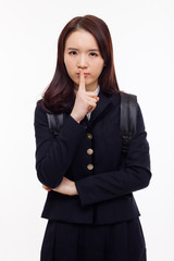 Young Asian student showing calm sign